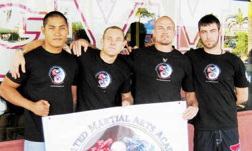 Members of Hervey Bay's Integrated Martial Arts team Chep Krummel, Greg Atzori, trainer Michael Green and Dale MacKenzie.