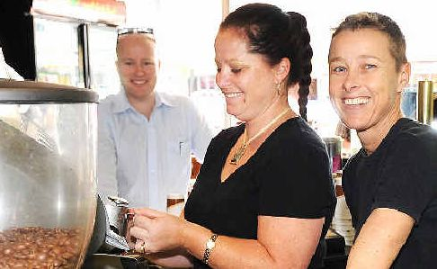 Hot brews: Bluey's Cafe staff Sonia Hamilton (right) and Debbie Nabbe making coffee for customer Brian Lovegrove yesterday.