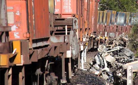 The remains of a 4WD after it collided with a freight train at Coramba.