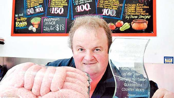 Andrew Grigor's Caloundra Business Award shares pride of place with his best-selling sausages.