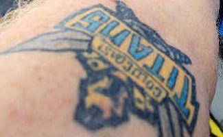 That's art: Gold Coast Titans fan Peter Burles shows off his new tattoo ahead of tomorrow's semi-final clash.