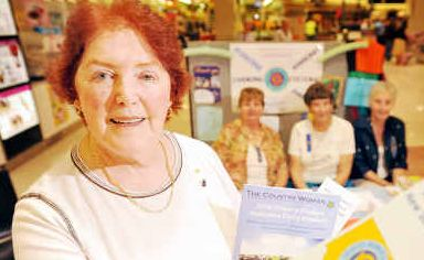 Judy Richardson, president of the Grafton CWA, hands out information with fellow member Lesley McFarlane and South Grafton Evening CWA members Barbara Green and Marjorie Astbury at Grafton Shoppingworld.
