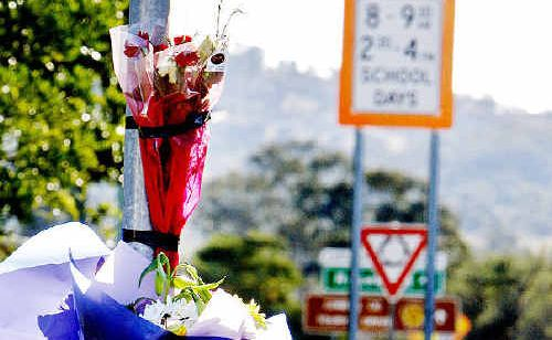 Flowers at the spot where Ivan Sthrowski-Wood was struck.