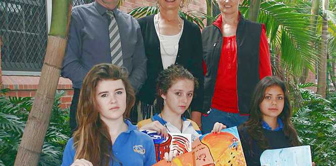 Mullumbimby High School principal Ian Graham (letf) with Byron Shire Mayor Jan Barham, art teacher Chris Davis and award-winning students Daisy Buckthorpe, Maya Moses and Arianne Kasi.