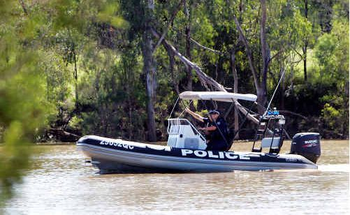 Sergeant Jeff Barnett and Constable Matt Habermann from Gladstone Water Police search for a missing man in the Dawson River at Baralaba.
