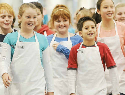 Kalkie State School student Isabella Beutel (far left) lines up with the other contestants of Junior Master Chef.
