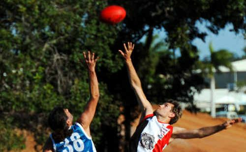 Hervey Bay Seagulls' David Beach and Brothers Bulldogs' Andrew Hatfield contest the bounce at Faircloth Oval.