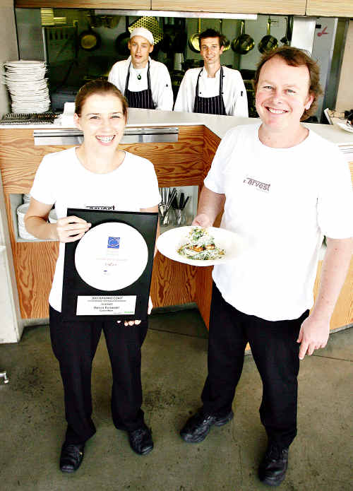 Harvest owners Belinda and Tim Absalom and chefs Simon Mercer and Paul Gilligan celebrate the restaurant's win.
