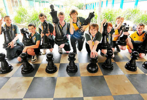 Kepnock State High School chess club members pit their brains and strategy against each other using the school's new giant chess set.
