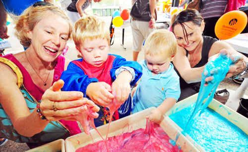 Helena Chandler, Patrick Bond, Harrison Keightley and Judy Keightley know any time is a good time for slime, as they get dirty during the PCYC's Rainbow Day as part of Child Protection Week.