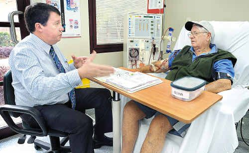 Health minister Paul Lucas with dialysis patient 75 yr old Glynn Turner from Maryborough in the renal unit at Hervey Bay Hospital.