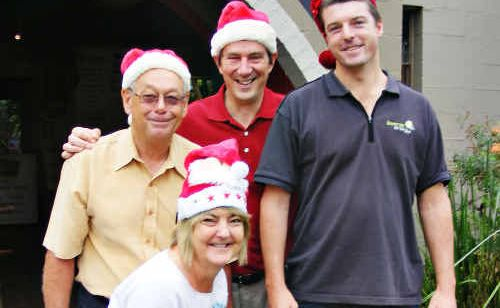 Don Hurley (left), secretary of the Lennox Head Lions Club; Tony Gilding, owner of the Macadamia Castle at Knockrow; Ballina Shire Councillor Jeff Johnson; and Louise Owen, president of the Lennox Head Chamber of Commerce; are happy over the $5000 donation given by Mr Gilding to save the Lennox Head Christmas Carols.