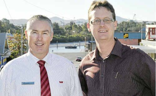 Westpac Bank manager Lance Harding and The Observer general manager Carl Carter.