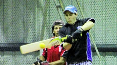 Ice batsman Robert Armatys sends one towards the nets.