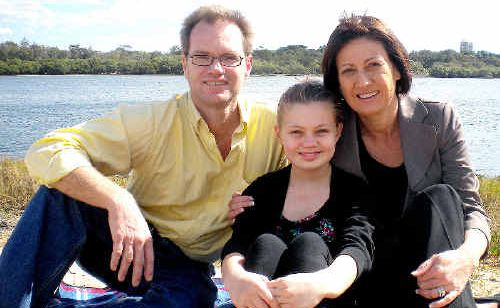Richmond MP Justine Elliot with husband Craig and daughter Alex, 11. Ms Elliot stepped down as Ageing Minister to spend more time with her family.