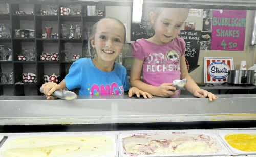 Winning guessers Jorja and Rianna Foley decide which flavour will be the first of 52 ice-creams sampled as part of their prize on Saturday.