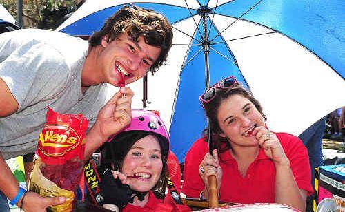 Urangan high entrants Danny Hindmarsh, Meg Krahn and Melissa Herlihy enjoy an energy hit prior to the racing on Saturday.
