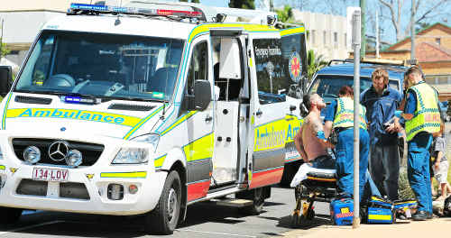 Paramedics attend to Brian Byrnes, who was hit by a four-wheel drive on Quay Street.