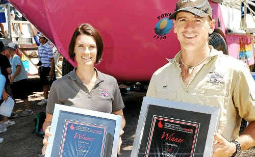 Katherine and Neil Mergard with the tourism awards the LARC has won. Photo: Mike Knott lar1309a