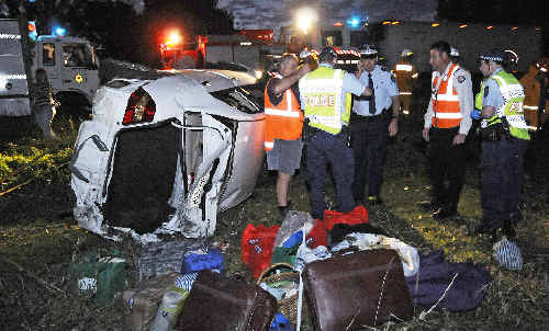 Three injured: The white Toyota sedan involved in last night's accident with a truck on the Pacific Highway, just north of Woodburn.