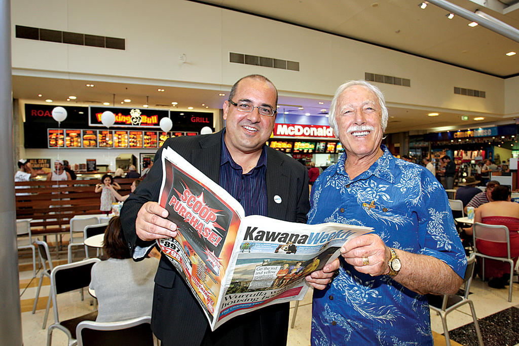 Daily editor in chief Mark Furler checks out the new Kawana Weekly with his dad, Bill Furler, who is a long-time local and Kawana resident.