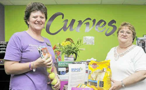Sue Wright and Carol Riggs from Curves Gym are donating pet food to the RSPCA, Phillip Street, Gladstone.