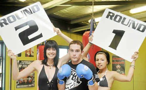 Card girls Renae Young (left) and Sky Wieland (right) with PCYC boxer Sam Nicol.