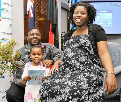 Desire Banda, Wezi Banda and Nomatemba Ntenezi at the citizenship ceremony held in the council chambers.