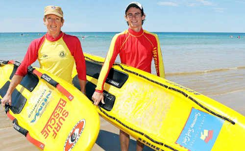 Volunteer surf lifesavers Julie Davis and Jamie Findlay at Nielson Park Beach.