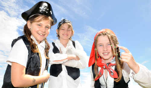 Shanay Jackson (Captain Cliff), Jordan Bird (Captain James) and Cherryella Fields (Captain Slapeys-Crew) get into the spirit of International Talk Like a Pirate Day at Tin Can Bay State School yesterday.