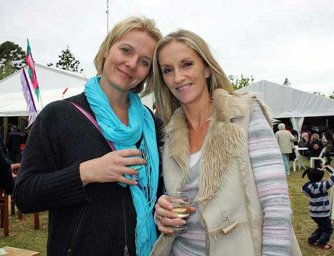 Debra Bywater and Stacey Bell sample wine at the Ergon Energy Flower, Food and Wine Festival, Queens Park.