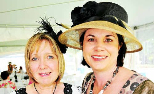 Bev Bennett and Joanne Loeskow looking smart at the Zonta High Tea Party.
