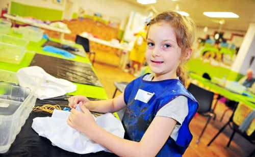 Sarah Krebs has an awesome time at Bundaberg Regional Art Gallery's holiday workshop for kids making tie-dyed T-shirts.
