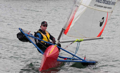 Danon Ware sails his Moth class dinghy towards the start line.