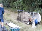 Smashed up: The driver of a utility retrieves items from her horse float at the Tiki Rd accident at Moonee.