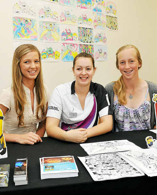 Cassie Pearson, Tiffany Elsworth and Jacinta Pearson help out with the school holiday fun activities at Hinkler Central.