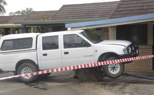 Holden Rodeo creates Gladstone's first drive-through motel after the driver mounted the footpath and slammed into a carport of a room.