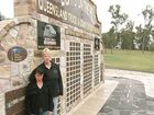 Lights on the Hill members Chris Eggins (left) and Kathy White at the current memorial wall at Lake Apex.