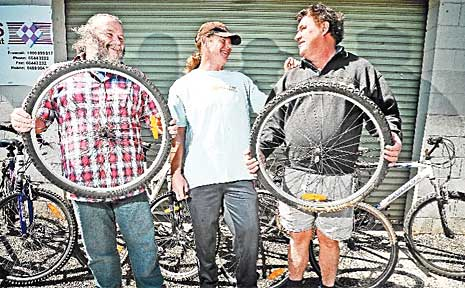 Stephen Milne, supervisor Scott Buckley and Tony Robinson show off some of the work done through the CHESS bike recycling program.
