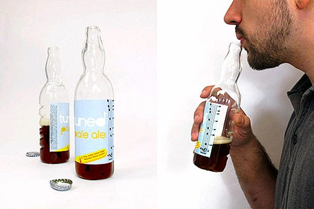 Tuned Pale Ale bottles feature markers indicating the notes produced by blowing over the neck of the bottle at various liquid levels, a notched side intended to be strummed with the cap, and an upside down holder which works as a tongue drum.