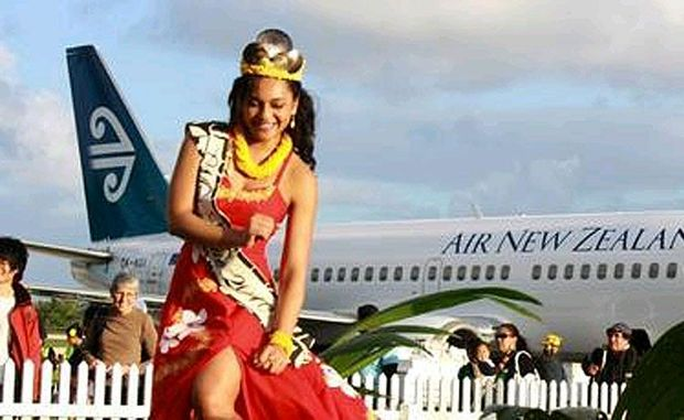 Maria Mitimeti, crowned Miss Niue, performs an impromptu dance for passengers at the airport.