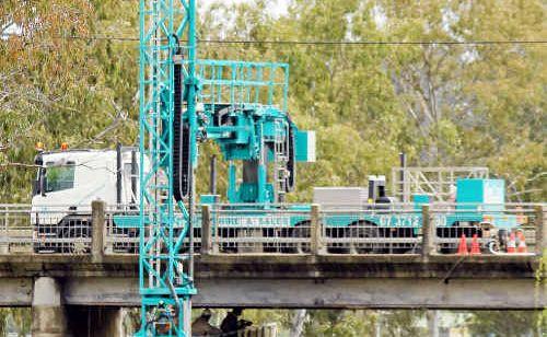 The under bridge inspection unit cleaning the bridge.