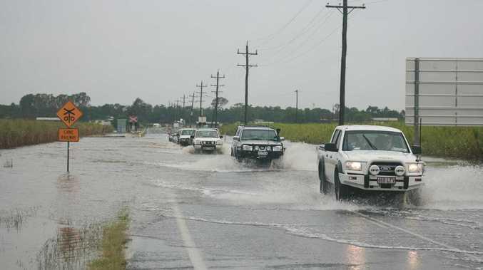 Vehicles making the trek across Hamilton Plains near Proserpine on Monday just before 1pm.