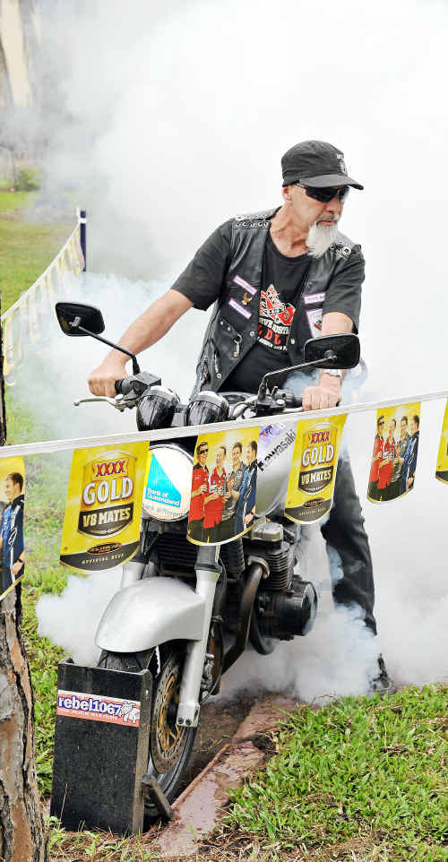 Consolidated Bikers Association Wide Bay member Poppy doing a burn-out on a Kawasaki 750 donated by the Bank of Queensland and auctioned for charity.