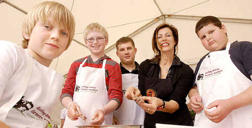 Preparing kebabs under the expert eye of MasterChef Geni Papacostas are budding chefs (from left) Angus Durak, Aaron Wright, Mitchell Crosby and Jayden Wakelin.
