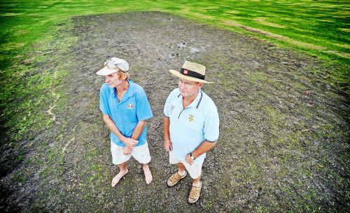 Damage done: Curator Tony Blanch and CVCA president Jeff Hackett look at the muddied cricket pitch at McKittrick Park damaged at the weekend.