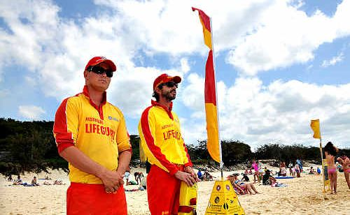 Rainbow Beach Lifeguards Lleam Rees and James Cahill keep an eye on a busy day at Rainbow Beach.