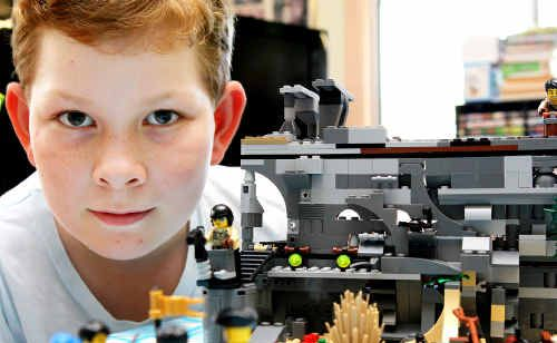 Evan Brown puts together another of his imaginative Lego creations that only last until he needs the blocks for a new piece.