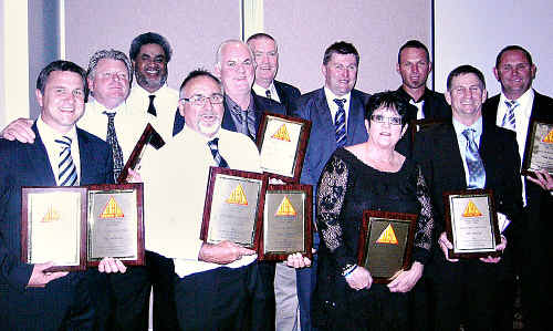 Members of the Gympie Cats football club inducted into the Sunshine Coast Australian Football Hall of Fame are (from left) Dean Warren, Roy Groom, Ned Piggott, Ray Warren, sons of John McMullen: Steve and Peter, Michael Crough, Helen Warren, Angus Nevin, Bob Baldry's son Marty, and Glenn Warren. Absent are Kevin and Val Andrews.