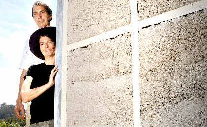Alternative builders Patricia Schmidt and Graham Sippo of Larnook using secret hemp mixture to fill the wall cavities of their home before rendering it to improve its liveability.